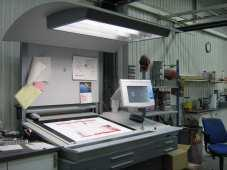 Theory Figure 13: The light table and the touch screen in connection with the printing press According to the printing press manufacturer Heidelberg Druckmaschinen AG, a Heidelberg Speedmaster CD